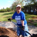 Jackie Hobbs, wearing Sealevel's volunteer t-shirt, helps landscape at A Child's Haven.