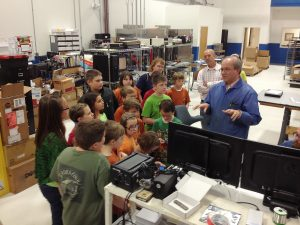 Bobby Richardson, Director of Operations at Sealevel Systems Inc., demonstrates circuit board assembly to Crosswell Elementary STEM Club.